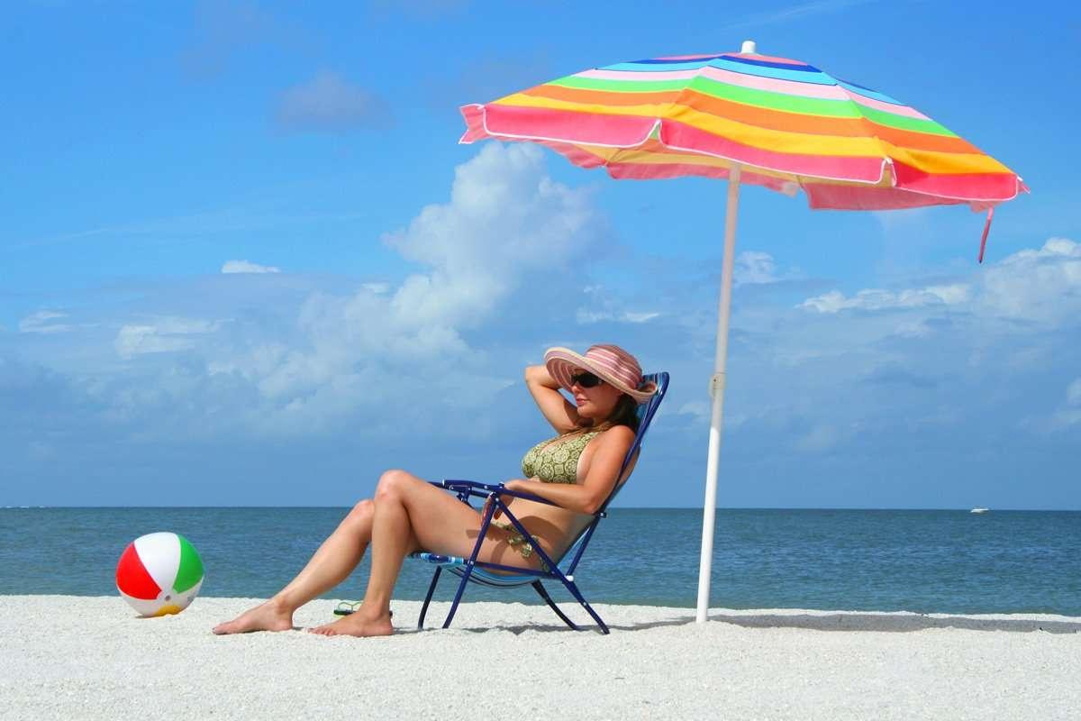 Beach umbrella vs. sunscreen. Which works better?