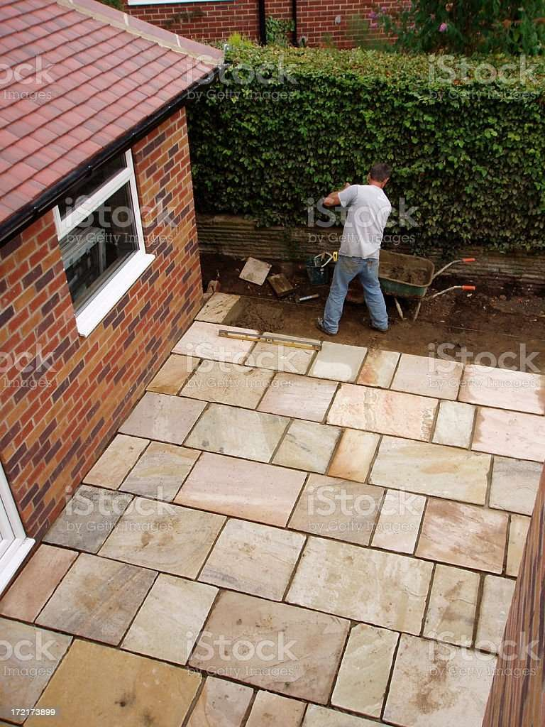 Man Laying Patio Paving Slabs In House Garden Stock Photo ...