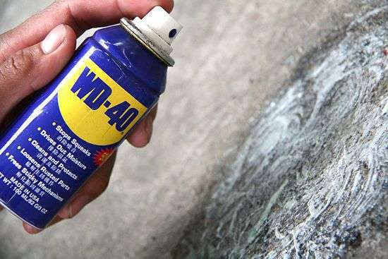 removing oil stains from driveways with wd 40 cleaning