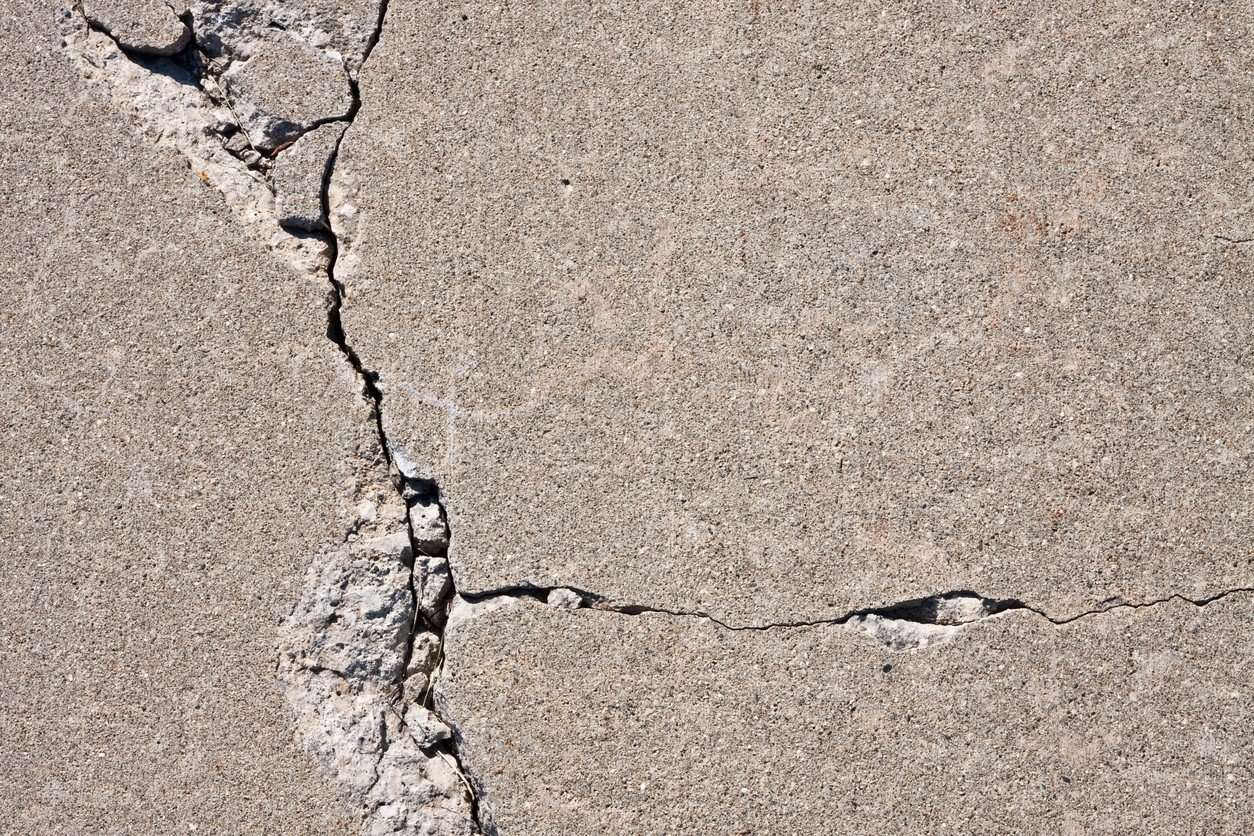 Solved! What to Do About Cracks in a Concrete Driveway ...